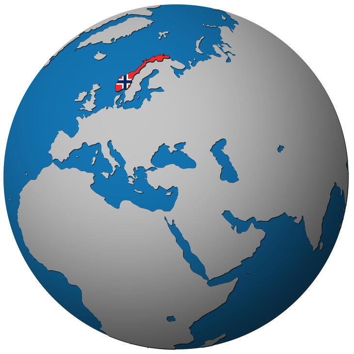 Norge markert med det norske flagg på en globus.
